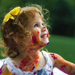 Child with paint on her face
